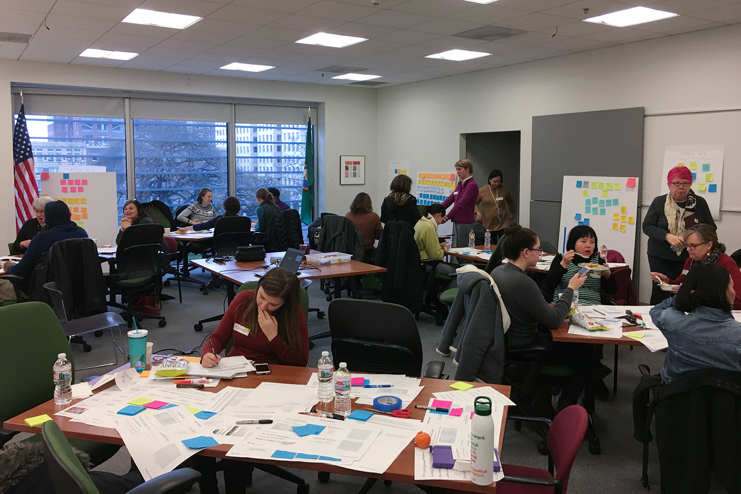 Innovation lab with city employees, service providers, and residents